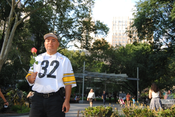guy-poses-with-rose